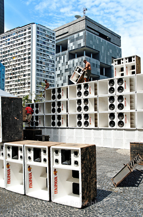 """Assembly of the giant Furacão (""""hurricane"""") soundsystem. For the first time in Baile Funk history, 10 soundsystem occupied the heart of the historic center of Rio de Janeiro for the 1st """"Funk Parade""""; sound from the periphery & favelas celebrated at the Largo da Carioca. In the background, the Petrobras headquarter."""