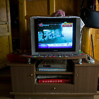 APRIL 4,2012 : a TV set is seen in a momads' house in Tongren county . Many locals secretly watch foreign TV or listen to VOA ( Voice of America) in orer to get the latest info on the stuation of the Tibetans.