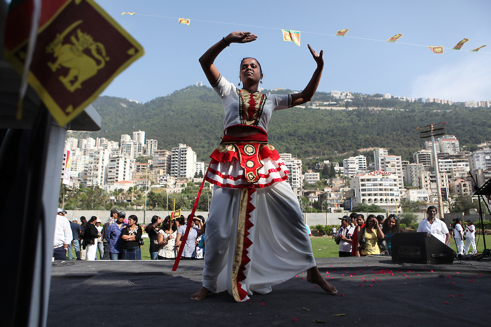 A Sri Lankan woman performs a traditional dance at a New Year's celebration in Jounyeh.