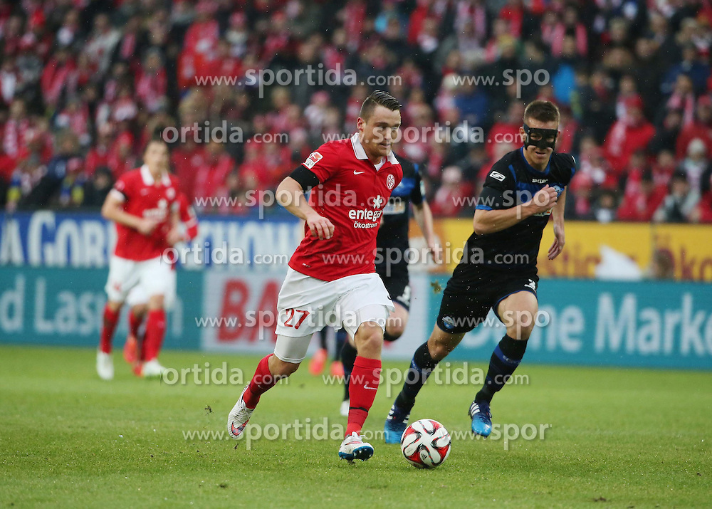 31.01.2015, Coface Arena, Mainz, GER, 1. FBL, 1. FSV Mainz 05 vs SC Paderborn 07, 18. Runde, im Bild v.l.: Christian Clemens (Mainz) gegen Uwe Huenemeier (SCP) // during the German Bundesliga 18th round match between 1. FSV Mainz 05 and SC Paderborn 07 at the Coface Arena in Mainz, Germany on 2015/01/31. EXPA Pictures &copy; 2015, PhotoCredit: EXPA/ Eibner-Pressefoto/ Neurohr<br /> <br /> *****ATTENTION - OUT of GER*****