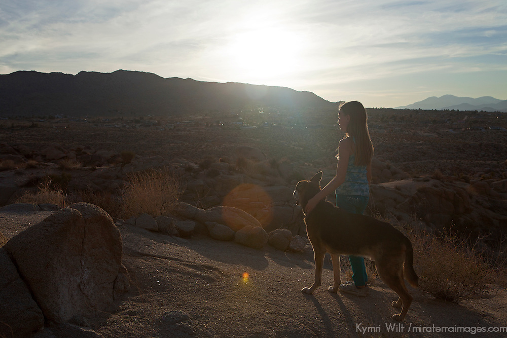 USA, California, Joshua Tree. A girl and her dog in Joshua Tree.