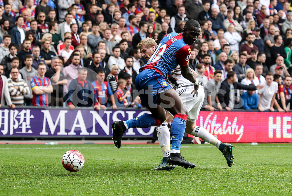 Yannick Bolasie of Crystal Palace is stopped in his tracks during the Barclays Premier League match between Crystal Palace and West Bromwich Albion at Selhurst Park, London, England on 3 October 2015. Photo by Ken Sparks.