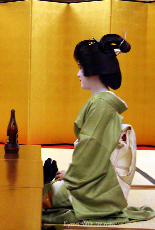 Asia, Japan, Kyoto. A sitting Geisha in profile.