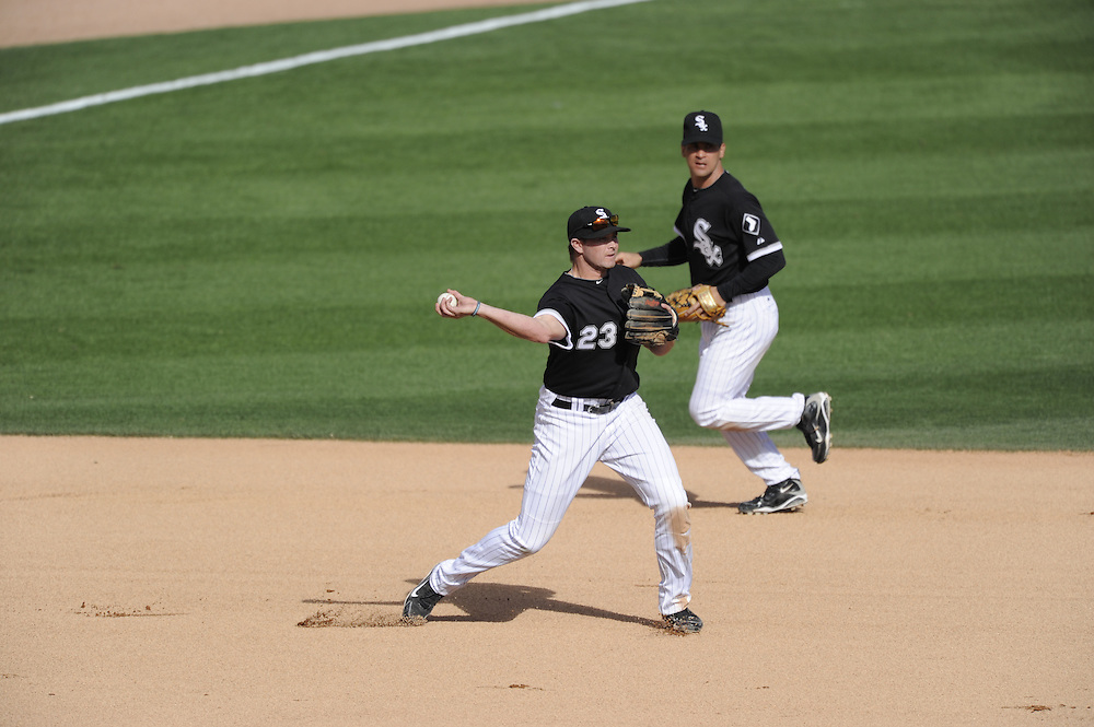 GLENDALE, AZ - MARCH 07:  Mark Teahen #23 of the Chicago White Sox fields a ground ball and throws to first base against the Cleveland Indians on March 07, 2011 at The Ballpark at Camelback Ranch in Glendale, Arizona. The game ended in a 16-16 tie. (Photo by Ron Vesely)