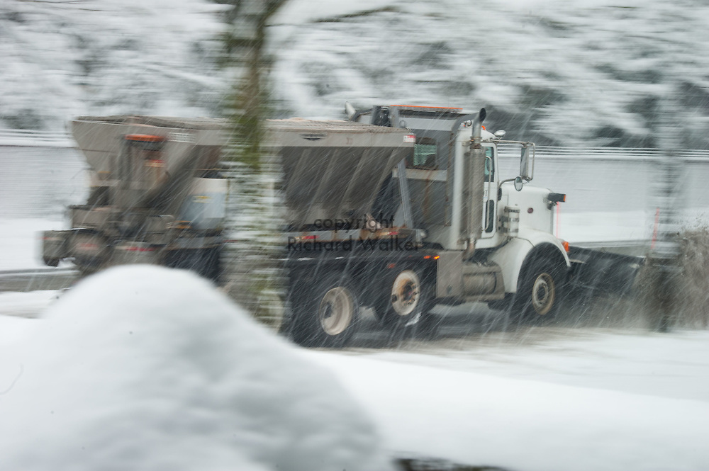 2017 FEBRUARY 06 - A SDOT (Seattle Department of Transportation) snow plow truck drives down a street in snow in a West Seattle neighborhood, Seattle, WA, USA. By Richard Walker