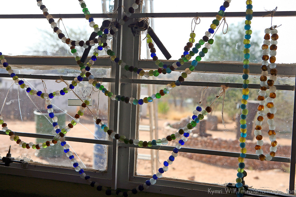 Africa, Namibia, Windhoek. Beads crafted from recycled glass hang in the window at Penduka development cooperation organization.