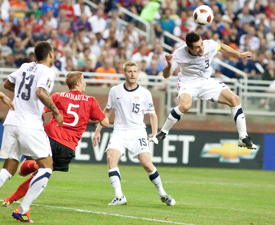 GR8007 -20110607- Detroit, Michigan,USA<br /> Carlos Bocanegra of the United States heads the ball during the US's CONCACAF match against Canada at Ford Field in Detroit Michigan, June 7, 2011.<br /> AFP PHOTO/Geoff Robins