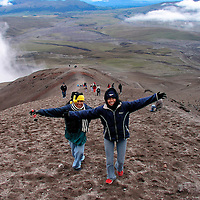 Park visitors climbing  up to  the Jose Ribas Hut located at 15,000 feet in Cotopaxi National Park in Ecuador.