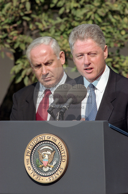 US President Bill Clinton with Israeli Prime Minister Benjamin Netanyahu makes a statement prior to the Wye River Summit at the White House October 15, 1998 in Washington, DC. Netanyahu and Arafat are meeting in the US to try and revive the Middle East peace accord.