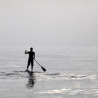 NC00523-00...NORTH CAROLINA - Stand up paddle surfer at the north end of Wrightsville Beach.