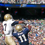 Notre Dame Junior Wide Receiver (#7) TJ Jones Ricky goes up for the  ball but Navy CB (#11) Kwesi Mitchell defends very well. Navy leads 21-10 at half time at The New Giant's Stadium in East Rutherford New Jersey