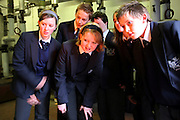 Pupils from The Bridgford School look inside their converted wood fuel boiler. The school is part Nottinghamshire Country Council who won the 2007 UK Ashden Award. The Ashden Awards for sustainable energy recognises projects finding ways to cut carbon dioxide emissions.