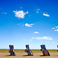 Cadillac Ranch, West of Amarillo, is a Route 66 mainstay and also off of US I-40. A dozen Cadillacs are buried in the West Texas Prairie. Passer by are free to spray paint the cars.