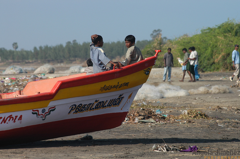 Children play in a beached fishing boat in Chinnangudi, a 540-family fishing village in Tamil Nadu, India on January 16, 2005, after nearly all the village's boats were destroyed by the Indian Ocean Tsunami on December 26, 2004. Generated by an earthquake on the ocean floor, the tsunami devastated the fishing industry along the southeastern coast of India. .