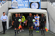 CAPE TOWN, South Africa - Monday 21 January 2013, referee and match officials exit the tunnel during the soccer/football match Grasshopper Club Zurich (Switzerland) and Jomo Cosmos at the Cape Town stadium..Photo by Roger Sedres/ImageSA