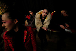 Models wait backstage before the Minzu University of China Collection  show during the Mercedes-Benz China Fashion Week in Beijing, China, 27 March 2013. The Mercedes-Benz China Fashion Week will run from 25 to 30 March.