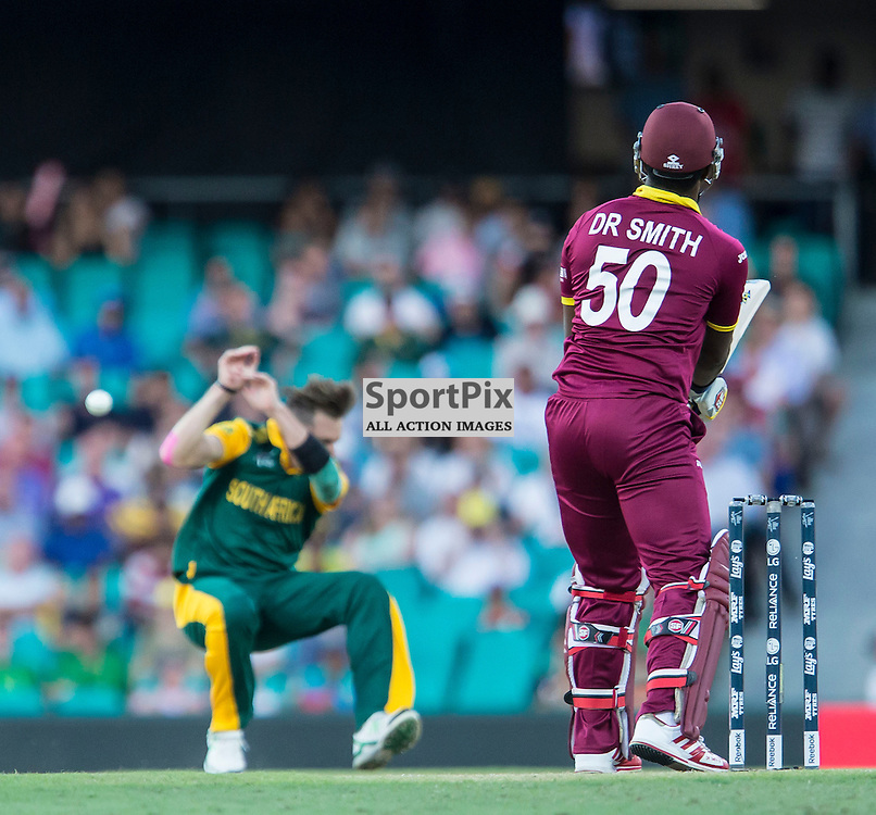 ICC Cricket World Cup 2015 Tournament Match, South Africa v West Indies, Sydney Cricket Ground; 27th February 2015<br /> West Indies Dwayne Smith hits a shot back at South Africa&rsquo;s Dale Steyn