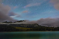 The Big Dipper (or Plough in the UK) over Pyramid Mountain and Patricia Lake in Jasper, Alberta. I shot this on a cloudy night, obviously, but with some clear breaks, after a day of cloud and rain on Labour Day, Sept 1, 2014. The waxing Moon was still providing some sky illumination, and there might have been some low level aurora adding a general glow to the north. This is a single exposure, for 30 seconds at f/2.2 with the 24mm lens and Canon 6D at ISO 3200.