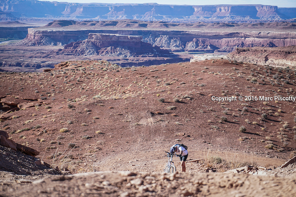 SHOT 10/15/16 4:31:30 PM - Paul Hobson of Steamboat Springs, Co. pauses while pushing his bike uphill during a climbing section along the White Rim Trail. The White Rim is a mountain biking trip in Canyonlands National Park just outside of Moab, Utah. The White Rim Road is a 71.2-mile-long unpaved four-wheel drive road that traverses the top of the White Rim Sandstone formation below the Island in the Sky mesa of Canyonlands National Park in southern Utah in the United States. The road was constructed in the 1950s by the Atomic Energy Commission to provide access for individual prospectors intent on mining uranium deposits for use in nuclear weapons production during the Cold War. Four-wheel drive vehicles and mountain bikes are the most common modes of transport though horseback riding and hiking are also permitted.<br /> (Photo by Marc Piscotty / &copy; 2016)