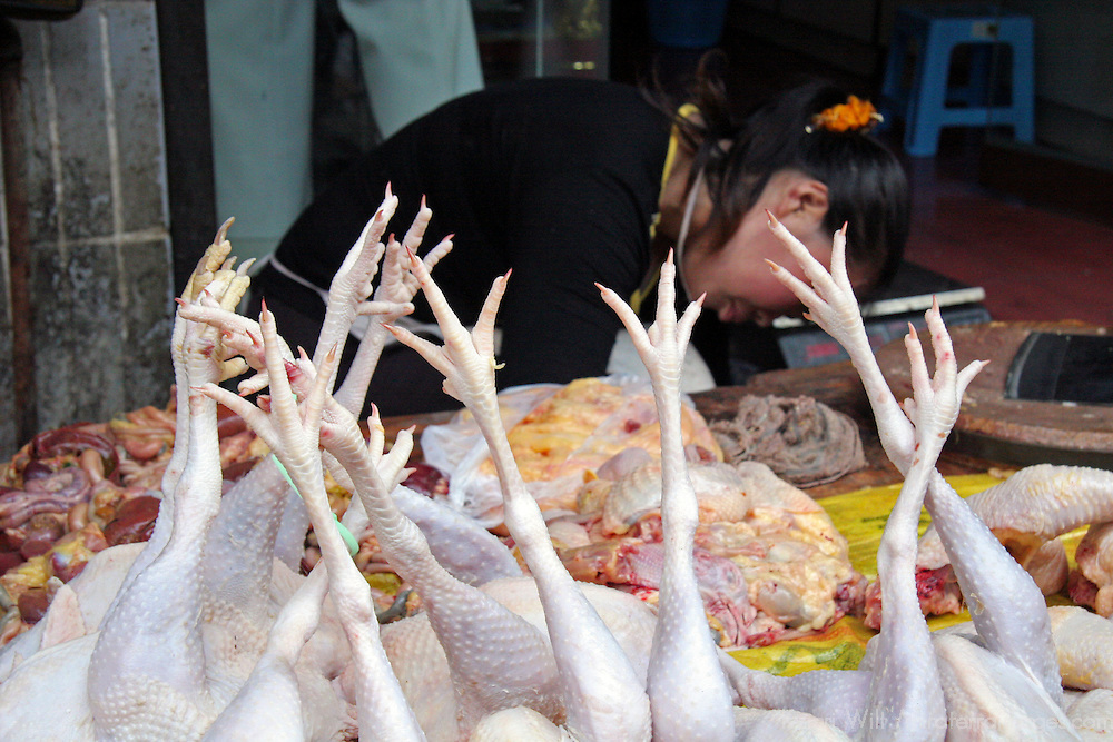 Asia, China, Chongqing. Chicken legs in local street market in the city of Chongqing.