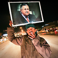 A supporter holds up a picture of Iraqi Kurdish leader and presidential candidate Jalal Talabani during the third night of celebrations in the Kurdish capital of Suleimaniya in northern Iraq. Kurds swept into second place in Iraq's historic elections, well-placed to secure a major parliamentary presence and top government jobs after decades of struggle against successive Sunni regimes. February 2005.