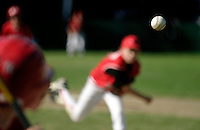 A baseball is caught in focus on a pitch by alittle league pitcher during a game in Brookline, Massachusetts.  Photo by Matthew Healey