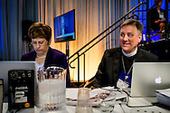 Barbara Below, assistant to LCMS President Rev. Dr . Matthew C. Harrison, and the Rev. Jon D. Vieker, senior assistant to the president, watch proceedings on Thursday, July 14, 2016, at the 66th Regular Convention of The Lutheran Church–Missouri Synod, in Milwaukee. LCMS/Michael Schuermann