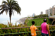 People stroll in a park in Miraflores on Sunday, Apr. 5, 2009 in Lima, Peru.