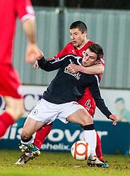 Raith Rovers's manager Grant Murray tackles Falkirk's Lewis Small..Falkirk 1 v 1 Raith Rovers, 5/3/2013.