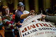 Supporters of Businessman and 2016 Republican presidential candidate, Donald Trump, reach for signs as they prepare to listen to Tump participate in a Q&amp;A format event with Liberty University President, Jerry Falwell, Jr  during a campaign event at the Adler Theater in Davenport, IA on January 30, 2016. Trump is in Iowa campaigning in the final days before the Iowa Caucus.<br /> <br /> The Iowa Caucus is the first major electoral event of the nominating process for President of the United States. Both the Democratic and Republican Iowa Caucus will occur on February 1, 2016.