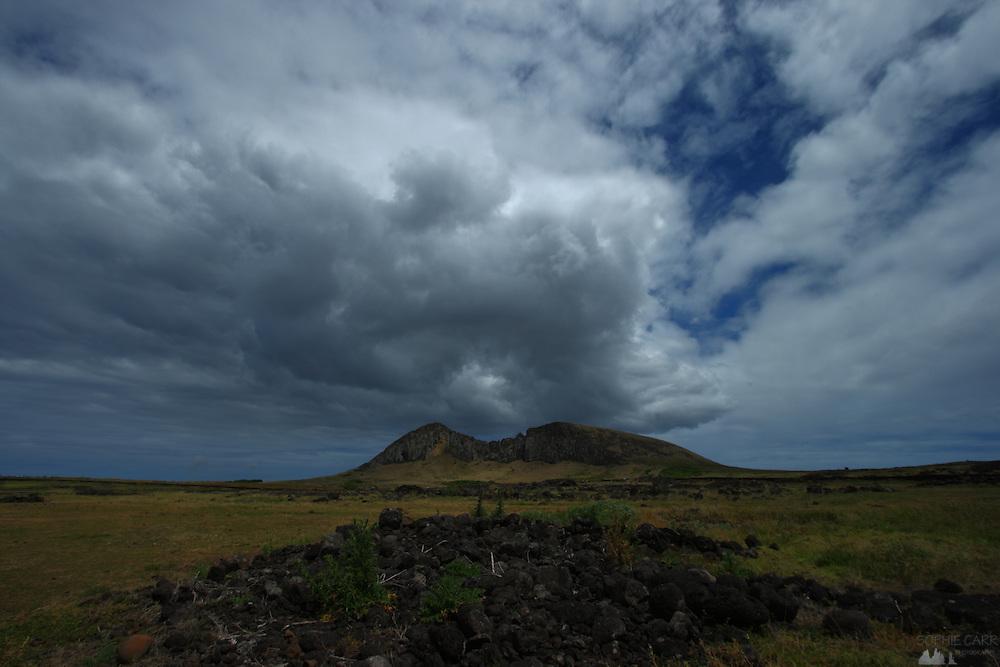 A big cloud amasses over the Rano Raraku volcano in Easter Island