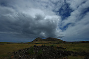 A big cloud amasses over the Rano Raraku volcano in Easter Island