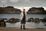 Nicol Nicolson from Visit Scotland, wearing a black leather kilt from 21st Century Kilts. Photographed at Yellowcraig Beach East of Edinburgh, Scotland, UK.