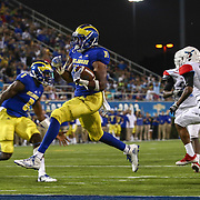 Delaware Running Back WES HILLS (31) scores a touchdown during a week one game between the Delaware Blue Hens and the Delaware State Hornets, Thursday, Sept. 01, 2016 at Tubby Raymond Field at Delaware Stadium in Newark, DE.