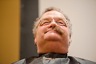 "The Rev. Dr. Matthew C. Harrison, president of The Lutheran Church–Missouri Synod, sits for a shave at ""the Great Mustache Shave Off"" during the Liberty National LCMS Campus Ministry Conference on Wednesday, Jan. 4, 2017, at the University of Maryland in College Park, Md. LCMS Communications/Erik M. Lunsford"