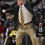 SHOT 2/26/11 4:48:53 PM - Colorado head basketball coach Tad Boyle on the sidelines coaching against Texas during their regular season Big 12 basketball game at the Coors Events Center in Boulder, Co. Colorado upset the fifth ranked Texas 91-89. (Photo by Marc Piscotty / © 2011)