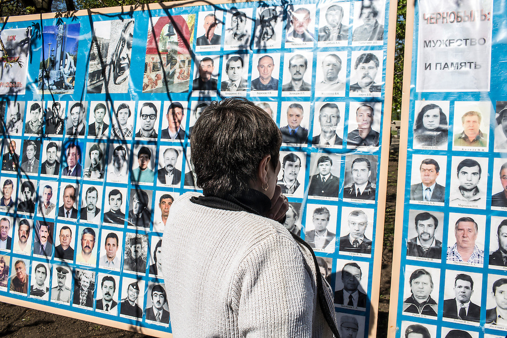 DONETSK, UKRAINE - APRIL 25:  A woman looks at photographs of victims of the 1986 Chernobyl nuclear accident following a memorial service to commemorate the annivesary on April 25, 2014 in Donetsk, Ukraine. The accident, which took place in the northern part of Ukraine, is considered the worst nuclear accident in history. (Photo by Brendan Hoffman/Getty Images) *** Local Caption ***