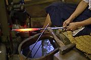 Japanese Swordsmith, Muneyasu, working at his studio in Saitama, Japan. He is part of the new generation of talented katana makers.
