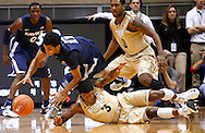 WEST LAFAYETTE, IN - DECEMBER 01: Dee Davis #11 of the Xavier Musketeers and Ronnie Johnson #3 of the Purdue Boilermakers scramble for a loose ball at Mackey Arena on December 1, 2012 in West Lafayette, Indiana. (Photo by Michael Hickey/Getty Images) *** Local Caption *** Dee Davis; Ronnie Johnson