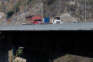 Trucks passing across the venezuelan major bridge called viaduct #1. This bridge is the key route to the country's main airport in Venezuela. Feb 27 2008. (ivan gonzalez).