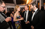 David Carr, Leslie Mann, Woody Harrelson, and Judd Apatow, from left, attend the Bloomberg Vanity Fair White House Correspondents' Association dinner afterparty at the residence of the French Ambassador on Saturday, April 28, 2012 in Washington, DC. Brendan Hoffman for the New York Times