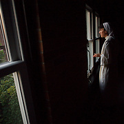 Sister Michele Armstrong, a novice at Our Lady of the Mississippi Abbey, rings the bell for morning Lauds.  For each toll of the Angelus, a prayer is said reflecting upon the incarnation of Christ and Mary.  The community of 22 Roman Catholic women follow Jesus Christ through a life of prayer, silence, simplicity and ordinary work.  Their home is a beautiful monastery which sits high on a bluff, overlooking the Mississippi River.