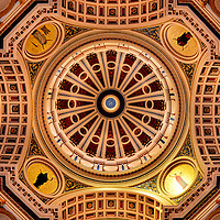 Pennsylvania State Capitol Rotunda Dome in Harrisburg, Pennsylvania<br /> The Pennsylvania State Capitol is called &ldquo;the palace of art.&rdquo;  This is an understatement for its lavish interior. The rotunda is charmed with a grand, imperial (two-sided) staircase that is adorned with Romanesque statues holding lite orbs. The number of stunning stained-glass windows, murals, tiles, golden molding and colorful stencils delight the eyes. The four round medallions near the dome&rsquo;s base represent religion, art, justice, and science. Also shown are two of the four other murals: The Spirit of Vulcan is on the left and the Spirit of Light is on the right.