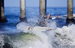HUNTINGTON BEACH, California/USA (Thursday,Aug 4, 2011) 10-Time ASP World Champion Kelly Slater (Cocoa Beach, FL), 39, shreds a wave during heat 6 thursday morning at the U.S. Open of Surfing 2011. Photo: Eduardo E. Silva.