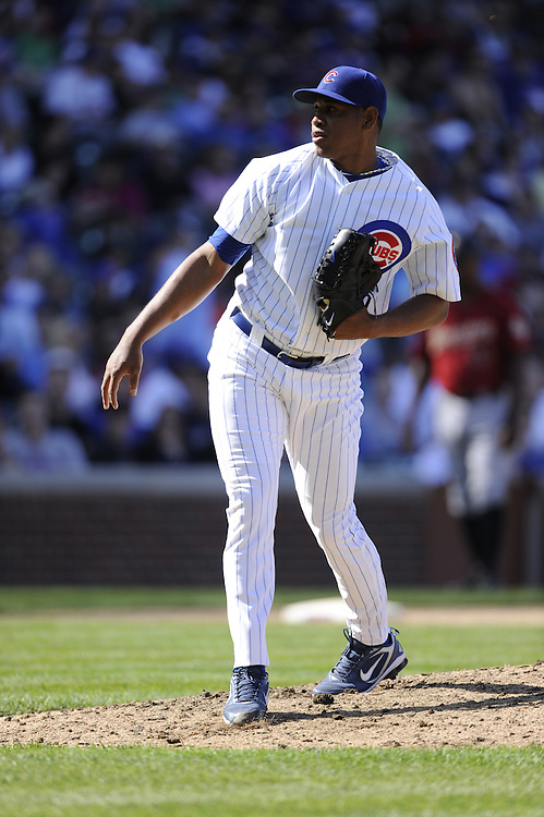 CHICAGO - APRIL 16:  Carlos Marmol #49 of the Chicago Cubs pitches against the Houston Astros on April 16, 2010 at Wrigley Field in Chicago, Illinois.  The Cubs defeated the Astros 7-2.  (Photo by Ron Vesely)