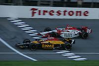 Bryan Herta beats Dan Wheldon to the finish at the Michigan International Speedway, Firestone Indy 400, July 31, 2005