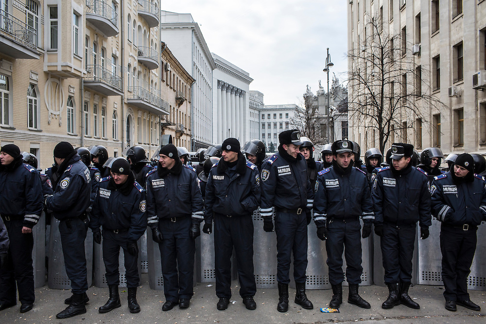 KIEV, UKRAINE - DECEMBER 4: Police officers block a street near a presidential administration building on December 4, 2013 in Kiev, Ukraine. Thousands of people have been protesting against the government since a decision by Ukrainian president Viktor Yanukovych to suspend a trade and partnership agreement with the European Union in favor of incentives from Russia. (Photo by Brendan Hoffman/Getty Images) *** Local Caption ***