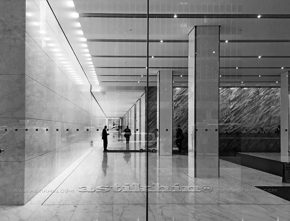 Indoor image of a office building lobby.