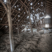 Old barn proceeding to give in to nature and start coming down.