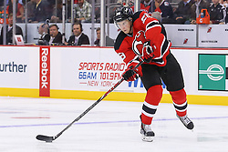 Oct 21, 2014; Newark, NJ, USA; New Jersey Devils defenseman Damon Severson (28) passes the puck during the first period of their game against the New York Rangers at Prudential Center.